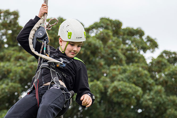 A young boy enjoying the zip wire